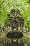 Marie De Medicis Fountain among trees in Luxembourg Gardens in Paris, France. View of Marie De Medicis Fountain among trees in Luxembourg Gardens in Paris royalty free stock image