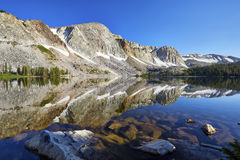 Marie Lake, Snowy Range, Wyoming. Reflection of mountain peaks in Marie Lake, located in the Medicine Bow mountain range of southeastern Wyoming royalty free stock photos
