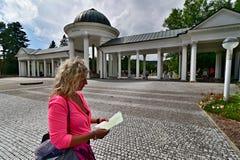 Marienbad - Mariánské lázně kolonáda. The Lady - Tourist in the Marienbad - Mariánské lázn Stock Photography