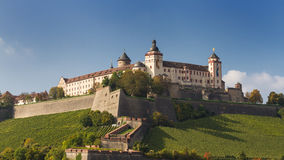 Marienberg Fortress rises about vineyards Stock Images