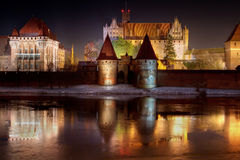 Marienburg castle in Malbork at night. With reflection in Nogat river, Poland - the world's largest brick castle Royalty Free Stock Photo