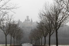 Marienburg castle in winter seen through the trees in the fog royalty free stock photos