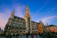 Marienplatz with christmas tree at sunset in Germany royalty free stock image