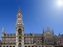 Marienplatz in Munich. With blue sky and sun royalty free stock photography