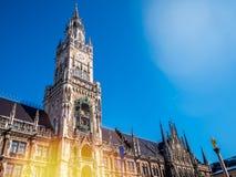 Marienplatz, Munich City. Famous munich city hall  under clear blue sky winter season flare lighting.New Town Hall and Frauenkirch. E, Bavaria, Germany Royalty Free Stock Photo