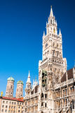 Marienplatz Munich. View of the townhall with carillon, cathedral and golden statue from Marienplatz - Munich Germany (02/2008 Royalty Free Stock Photos