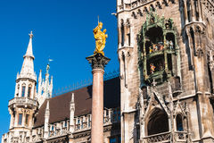 Marienplatz Munich. View of the townhall with carillon and golden statue from Marienplatz - Munich Germany (02/2008 Royalty Free Stock Image