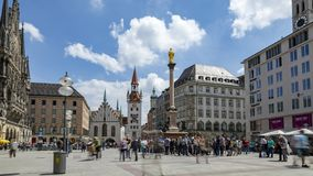 Marienplatz, Munich, time lapse. Long time exposure time lapse shot of the Marienplatz St. Mary`s square, the central square in the city of Munich, Germany, with stock video footage
