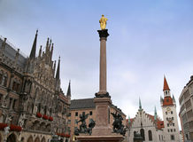 The Mariensaule, a Marian column and Munich city hall on the Mar Stock Images