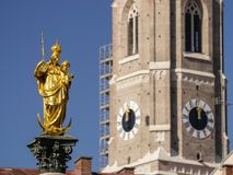 Marienstatue and Frauenkirche at the famous Marienplatz in Munich, Germany Stock Photography