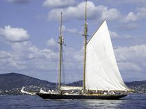 Mariette. Two mast classic sailing yacht folding the sails Stock Photo