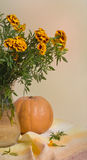 Marigold bouquet and pumpkin Royalty Free Stock Images