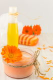 Marigold cosmetics products with fresh flower bouquet. Marigold natural cosmetics products with fresh flower bouquet stock photography