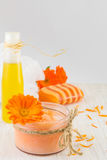 Marigold cosmetics products with fresh flower bouquet. Marigold natural cosmetics products with fresh flower bouquet royalty free stock photos
