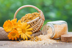 Marigold, dried plants and bottles of sea salt Stock Photo