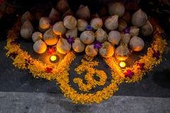 Marigold flower decorate on street floor of OM is symbol of hind Royalty Free Stock Photos