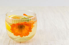 Marigold flower herbal tea with lemon slices Royalty Free Stock Images