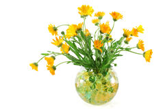 Marigold flowers in a vase with colorful  beads Stock Image