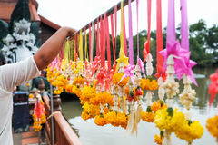 Marigold garlands holding on steel at the temple Stock Photo