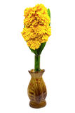 Marigold and pandan in brown vase for worship Royalty Free Stock Images