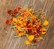 Marigold petals scattered on the old board in the cracks Royalty Free Stock Photography