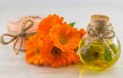 Marigold products with a fresh flowers bouquet. Marigold products with a fresh flower bouquet. Natural cosmetics royalty free stock photo