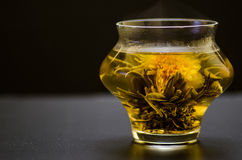 Marigold tea. Blooming marigold and white tea stock photos