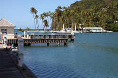 Marigot Bay Quay. The Yacht Quay and the Spit of land that forms the inner harbour or Hurricane Hole at Marigot bay St Lucia, a favourite haunt of Yachties Stock Image