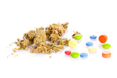 Marihuana and pills isolated on white background Royalty Free Stock Image
