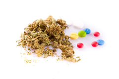 Marihuana and pills isolated on white background Royalty Free Stock Images