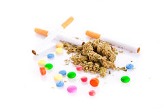 Marihuana and pills on white background, smoker Royalty Free Stock Images