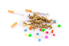 Marihuana and pills on white background, smoker drugs. Marihuana and pills on white background, smoker Stock Image