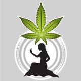 Marihuanablatt mit Mädchenschattenbild Stockfoto