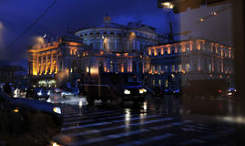 Mariisnky Theater in St. Petersburg, Russia on a Rainy Night. The legendary Mariinsky Theater in St. Petersburg glows in a sea of rain and reflections on a Royalty Free Stock Photos