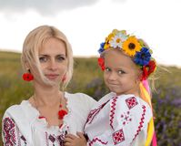Mother and daughter in ukrainian national costumes. Ukrainian mother and her little daughter stock photography