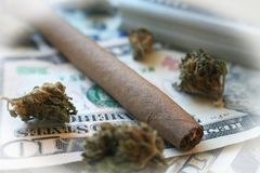 Marijuana Blunt With Stacks Of Money With White Frame