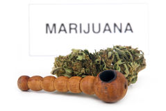 Marijuana bud and pipe. Medical marijuana drug bud and pipe royalty free stock images