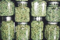 Marijuana Buds In Glass Jar Stack Stock Photos