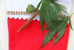 Marijuana Cannabis decorating Christmas stocking Royalty Free Stock Images