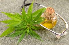 Marijuana, cannabis oil and stethoscope stock photography