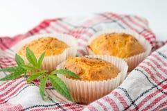 Marijuana cupcake muffins on a plate. Marijuana cupcake muffins and leaves on a plate Royalty Free Stock Photography