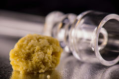 Marijuana extraction concentrate aka wax crumble on dark background royalty free stock images