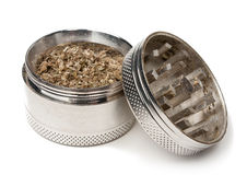 Marijuana grinder. A marijuana grinder filled with weed Royalty Free Stock Photography