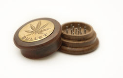 Marijuana grinder Stock Images