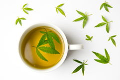 Marijuana herbal tea and cannabis leaves stock images