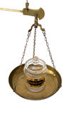 Marijuana jar on a brass scale weighing pan royalty free stock photos