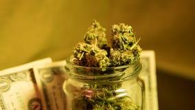 Marijuana in a jar. Cannabis joint. Medical or recreative stock photos