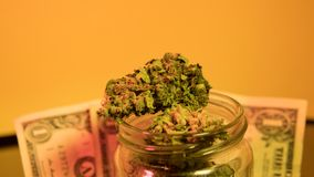 Marijuana in a jar. Cannabis joint. Medical or recreative royalty free stock photography