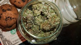 Marijuana in a jar. Cannabis joint. Medical or recreative stock photography