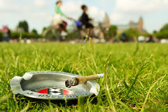 Marijuana joint in the background Amsterdam. The marijuana joint in the background Amsterdam Royalty Free Stock Images